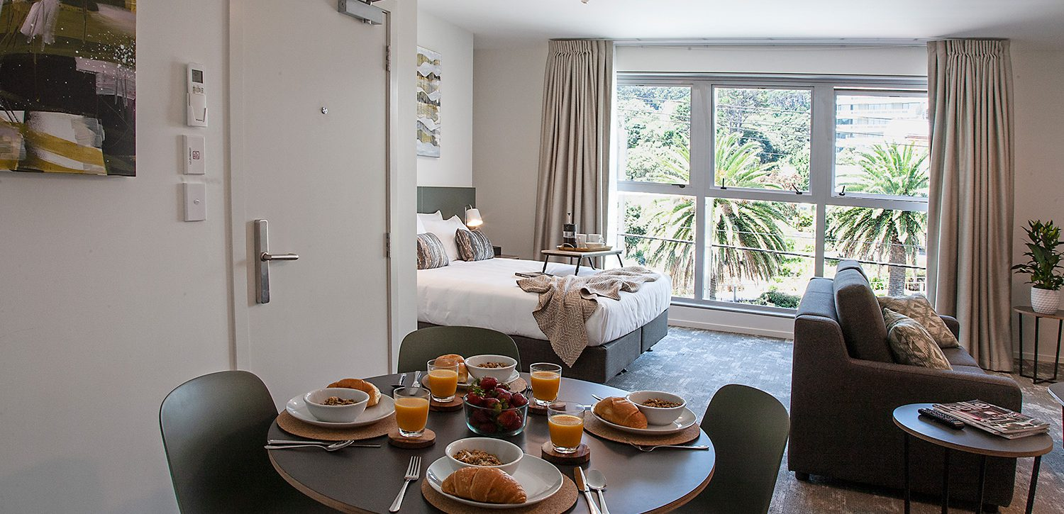 newtown-wellington-hotel-accommodation-deluxe-apartment-dining-lounge-bed | Sojourn®